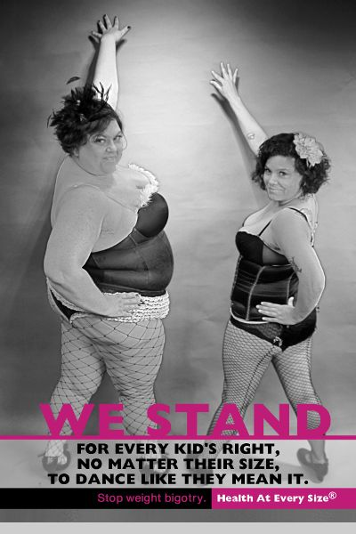 "A poster of two women in cabaret dancing garb, each with a hand against a wall, looking back toward the camera. The caption reads ""We Stand for every kid's right, no matter their size, to dance like they mean it. Stop weight bigory."""
