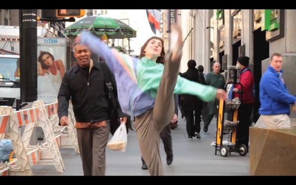 Young woman dancing in the middle of a New York City sidewalk