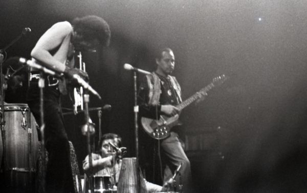 Black-and-white photo of three men playing instruments