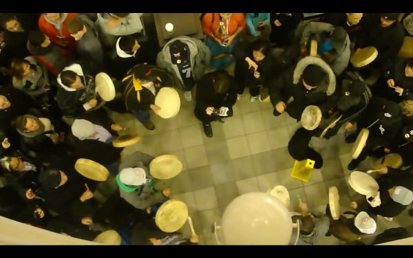 Photograph of a flash mob, viewed from directly above the center of the group