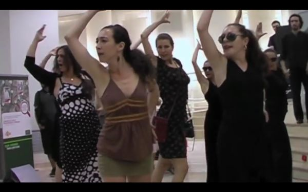 Nine dancers performing the flamenco in a bank