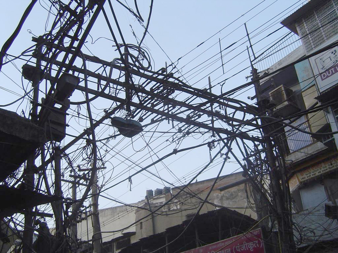 Tangled Overhead Wires, New Delhi, by Steve. https://www.flickr.com/photos/sasqrd/10669298/, CC BY-NC2.0.